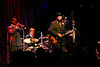 Big Bad Voodoo Daddy - Seattle (2006) : Jazz Alley, 2/24/06.  I've loved their music for years, and finally I got to see them play...  Critter and I loaded up on drinks and a swingin' time was had by all.  The music was loud & brassy, the drums were crisp and thumpy, and the guys really seemed to be enjoying themselves despite having to do another show just a half hour after the one we saw.  The bass player and Scotty (lead singer) were especially enjoying themselves, and I commented to Critter afterwards that it's nice to see musicians enjoy their work instead of acting bored (the vibe I got when seeing Cake last year).  BBVD are a talented, energetic group and if you like swing jazz you'd be nuts to miss 'em.