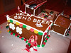 Gingerbread Trailer Park - 12/18/05 : Amy and Laura hosted a little Christmas gift exchange this year, with a little added bonus:  we got to build a trailer park made of gingerbread, various colored icing, and plastic cats & dogs (no humans were available).  It was silly & fun, and what a mess we ended up with!